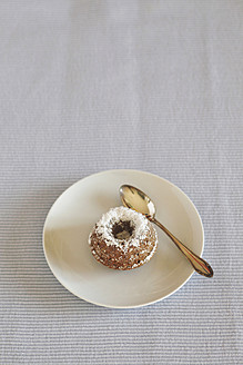 Miniature cakes with powdered sugar and spoon on plate - JTF000203