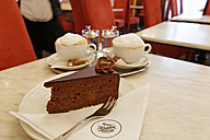 Austria, Upper Austria, Plate of cake with coffee on table - SIE003020