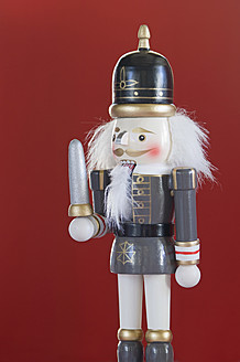 Close up of Nutcracker figurine against red background - ASF004677