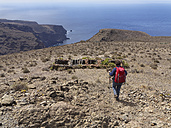 Spain, La Gomera, Woman walking on Las Pilas at Valle Gran Rey - SIEF003002