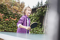 Germany, Leipzig, Boy playing table tennis, smiling - BMF000632