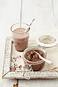Mousse au Chocolat in jar and hot chocolate in glass on table - ECF000169