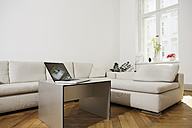 Germany, Berlin, Laptop on living room table - SKF000958