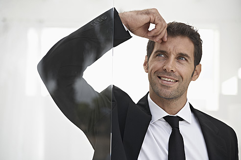 Spain, Businessman standing by door, thinking - PDYF000282