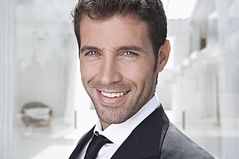 Spain, Businessman smiling, portrait - PDYF000348