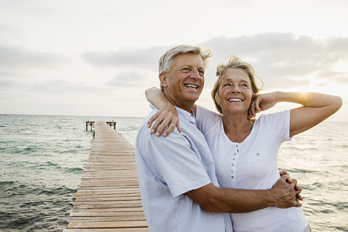 Spain, Senior couple embracing at the sea - JKF000021