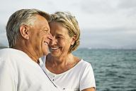 Spain, Senior couple at the sea - JKF000027