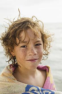 Spain, Portrait of boy at Atlantic Ocean, smiling - JKF000081