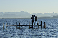 Europe, Germany, Bavaria, Man and woman relaxing at Lake Ammersee - CRF002207