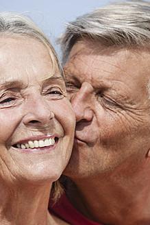 Spain, Senior man kissing to woman, close up - JKF000116
