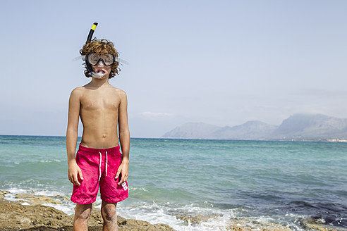 Spain, Boy with diving equipment on beach - JKF000143