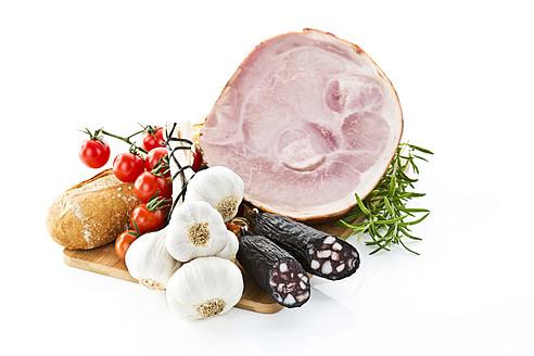 Ham, sausages, tomatoes, garlic, rosemary and bread, studio shot - MAEF005294