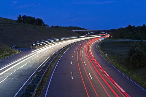Germany, Saarland, View of freeway at night - WDF001427