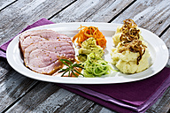 Smoked pork chop, mashed potatoes with roasted onions on plate, close up - MAEF005415