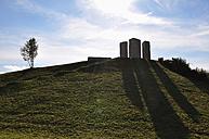 Germany, Bavaria, Aschheim, View of sculptured stone blocks on grass hill - AXF000391
