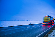 Austria, Cargo truck moving on country road in winter - EJWF000161