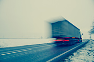 Austria, Cargo truck moving on country road in winter - EJWF000159