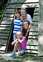 Austria, Portrait of friends in tent, smiling - WWF002728