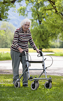 Austria, Senior woman pushing walking frame - WWF002466