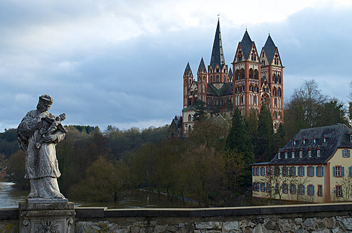 Germany, Hesse, View of Limburg cathedral with statue in front - MH000061