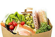 Groceries in paper bag on white background, close up - MAEF005523