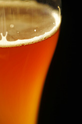 Glass of wheat beer against black background, close up - JTF000271