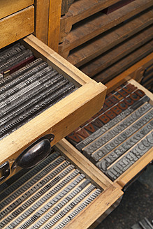 Germany, Bavaria, Detail of lead typesetting at traditional print shop - TC003295