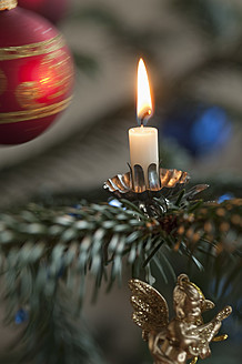 Christmas decoration with bauble, candle and angel, close up - CRF002271