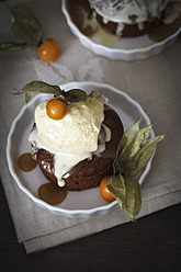 Sticky toffee pudding with vanilla ice cream and physalis in plate - EVGF000020