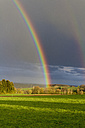 Europe, Germany, Rhineland-Palatinate, View of rainbow at rural landscape - CSF016225