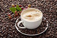 Cup of coffee with beans, close up - CSF016253