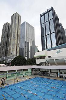China, Hong Kong, High-rise buildings behind swimming pool in Wan Chai - MIZ000191