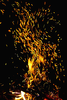 Germany, View of sparks from campfire - NDF000300