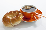 Cup of coffee with croissant on white background - CSF016595