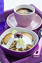 Bowl of muesli, plum and yogurt with cup of coffee, close up - CSF016598