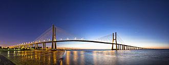 Portugal, Lisbon, View of Vasco da Gama bridge at River Tagus - FO004741