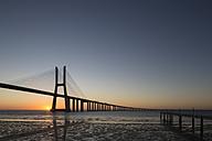 Portugal, Lisbon, View of Vasco da Gama bridge at River Tagus - FO004744