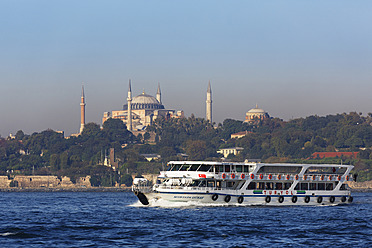 Turkey, Istanbul, View of ferry boat on Bosphorus with Hagia Sophia in background - SIE003307