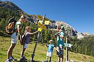 Austria, Salzburg, Family looking at signpost at Altenmarkt Zauchensee - HHF004364