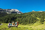 Austria, Salzburg, Family watching mountains at Altenmarkt Zauchensee - HHF004376