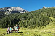 Austria, Salzburg, Family watching mountains at Altenmarkt Zauchensee - HHF004379