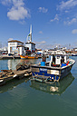 England, Hampshire, Portsmouth, View of fishing boats in harbour and Spinnaker Tower in background - WD001464