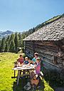 Austria, Salzburg Country, Family having rest at Altenmarkt Zauchensee - HHF004392