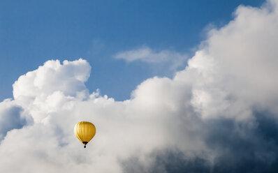 Austria, Hot air balloon at Oberhofen against cloudy sky - WVF000299