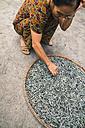 Vietnam, Hanoi, Woman with dried fish - MBE000543