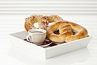 Pretzels sugar with cup of coffee on tray, close up - CSF016824