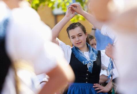 Austria, People dancing in tradtional clothing - WW002673