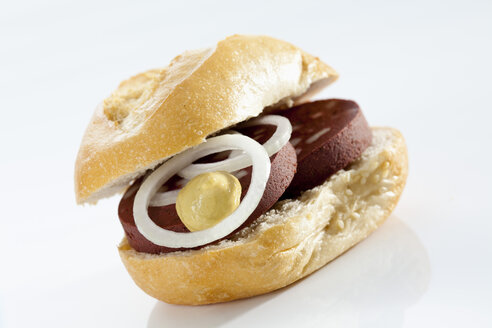 Sandwich of bread roll with black pudding on white background, close up - CSF017276