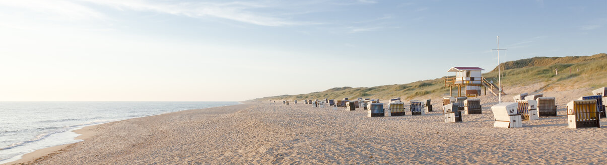 Germany, View of empty beach with roofed wicker beach chairs on Sylt island - ATA000004