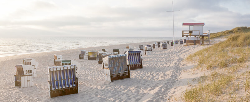Germany, View of empty beach with roofed wicker beach chairs on Sylt island - ATA000007
